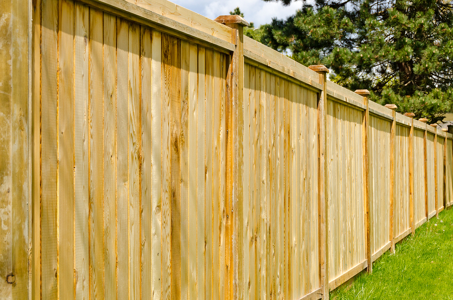 bigstock-wooden-fence-with-green-lawn-a-33737672